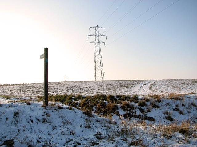 Electricity pylons in frozen field east of Hintlesham