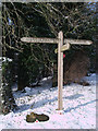 SU2071 : Signpost and Charles Sorley memorial stone, Poulton Downs by Vieve Forward