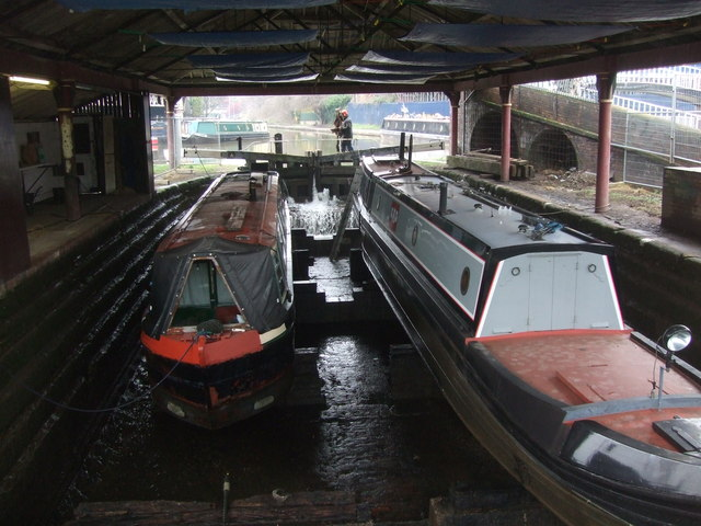 Two narrowboats in a graving dock