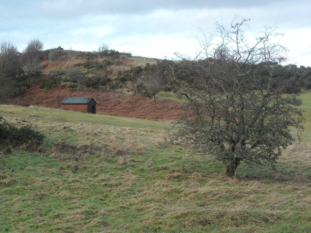 Small hut in the shadow of Torr Hill