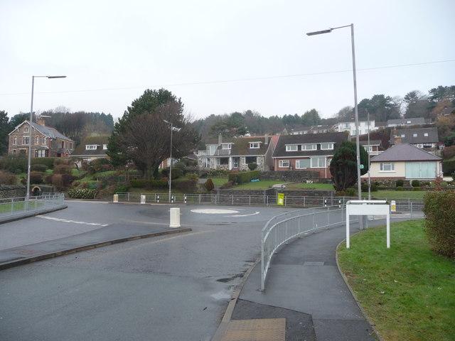 Mini roundabout outside a school