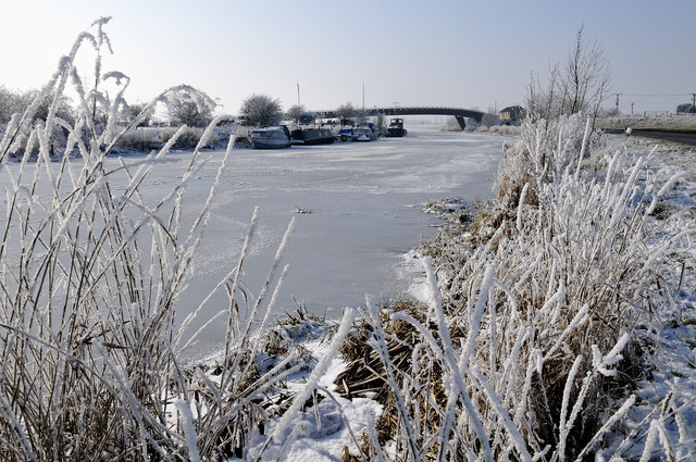 Millennium Bridge and frozen river Nene