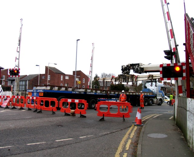 Rail Action at Oakham 10:Crane moves into position at level crossing