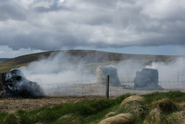 Burning old bales, Norwick