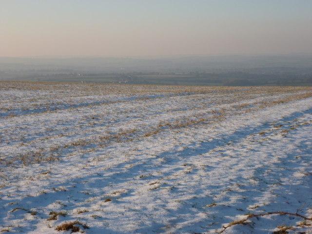 Okeford Fitzpaine: view down a snowy hillside