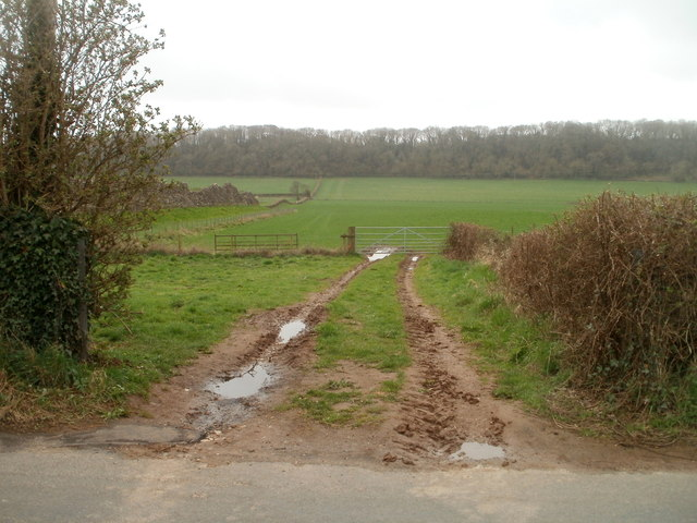 Muddy entrance to a field alongside the ancient west wall, Caerwent