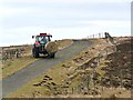 NY8588 : Tractor at Hareshaw Head by Oliver Dixon