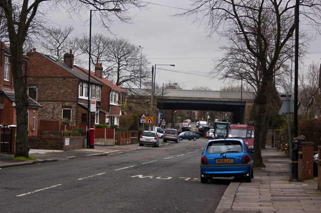 A cluttered Urmston Lane with the M60 bridge ahead