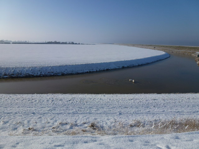 The Wash coast in winter - Snow covered field inside the sea bank