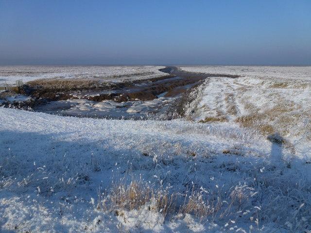 The Wash coast in winter - Lawyer's Creek crossing the frozen salt marsh