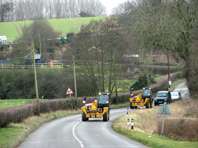 Farm vehicles on the road through Brightwell