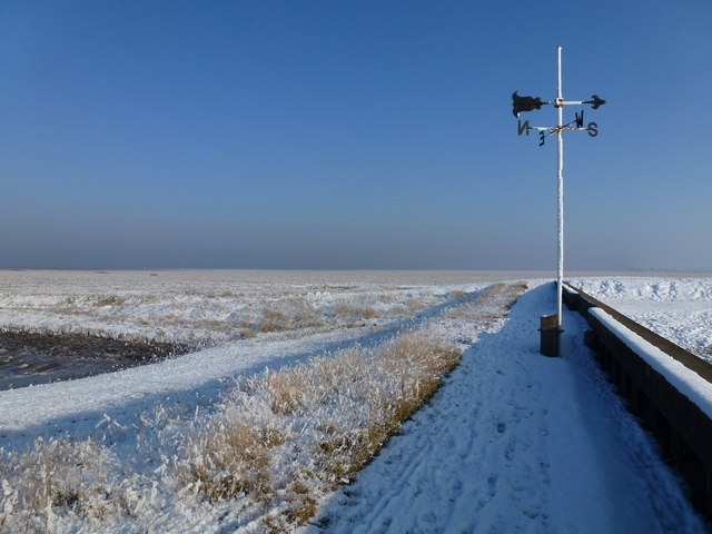 The Wash coast in winter - Weather vane on Lawyer's Creek outfall