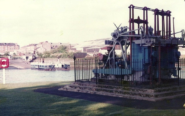 The marine engines from Paddle Steamer Clyde with the Renfrew Ferry on the background