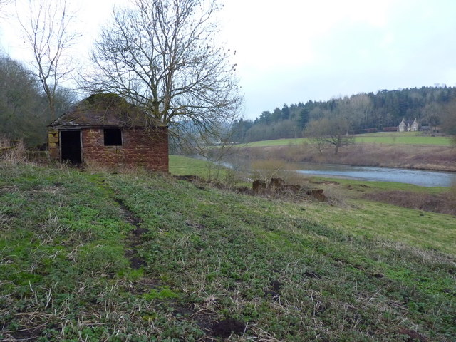 Small, derelict barn on the riverbank