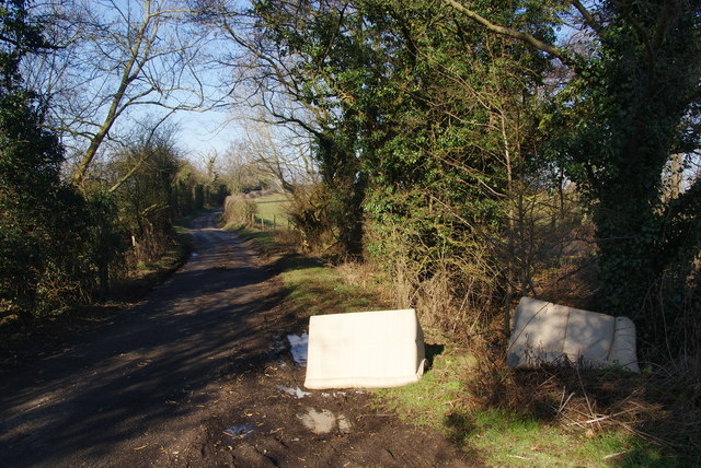 Discarded furniture by a country lane