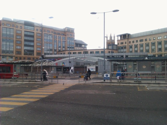 Hammersmith bus station with underground station and Broadway shopping centre beyond