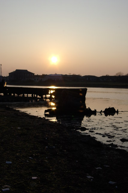Metal boat and barge at sunset, April 2009