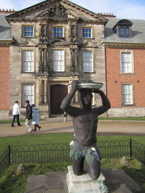 'Blackamoor' sundial and formal entrance Dunham Massey Hall