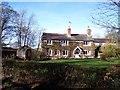 SJ5071 : Cottage on Moss Lane at Manley by Raymond Knapman