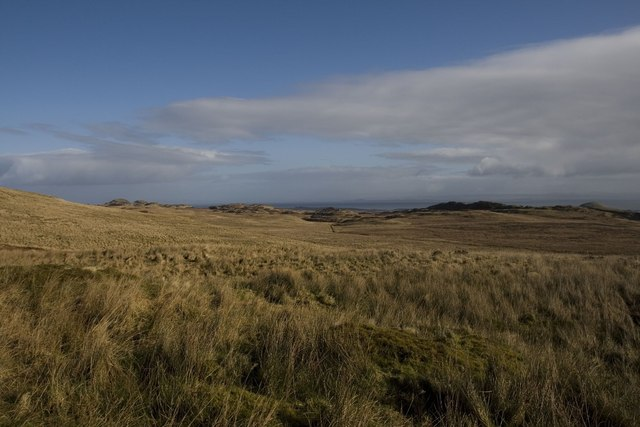 Looking across boggy grassland to Islay's east coast