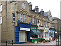SE2720 : Ossett - shops on south side of Station Road by Dave Bevis
