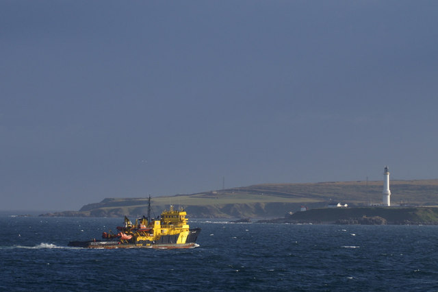 Oil supply ship passing Girdleness lighthouse, Aberdeen