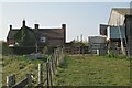SP1464 : Cottages at May's Hill Farm by Robin Stott