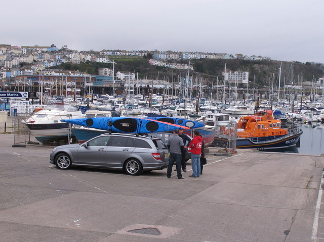 Sea kayaks on car roof, Brixham Harbour