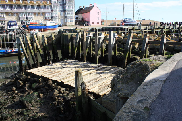 West Bay Inner Harbour entrance remains of old quay structure.