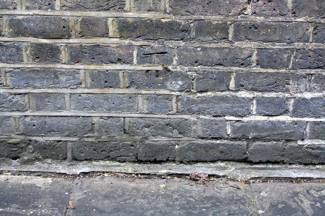 Benchmark on wall of Holland Walk