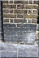 TQ2480 : Benchmark on wall pier of #58 Clarendon Road by Roger Templeman