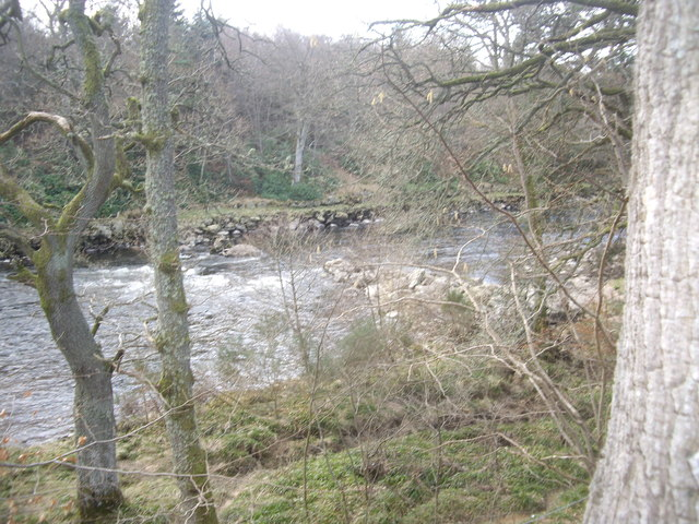 A weir-like restriction to the width of the River Dee