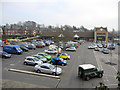 SJ9755 : Morrisons' car park and store by John S Turner