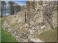 SP9908 : Foundations of later buildings adjoining the West Tower by Chris Reynolds