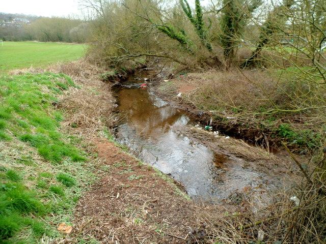 Malpas Brook flows away from a footbridge, Bettws, Newport