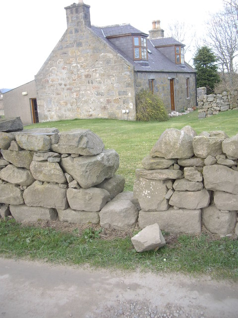 Stile across a dry stone wall