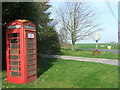 TL7640 : Telephone box And Village Sign by Keith Evans