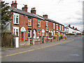 SJ8463 : Terraced housing in Holmes Chapel Road by Richard Dorrell