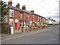SJ8463 : Terraced housing in Holmes Chapel Road by Richard Dorrell
