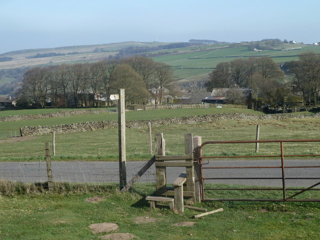 Moorland footpath reaches the lane above Abney Grange