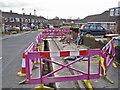 SJ8463 : Road works in Longdown Road by Richard Dorrell