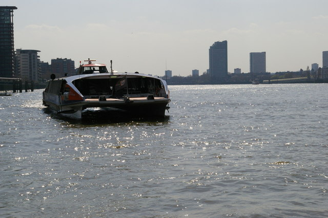 Looking downriver from Canary Wharf Pier: riverbus approaching