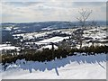 SK2177 : Snowy view towards Eyam from Bole Hill by Neil Theasby