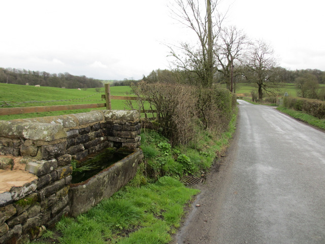 Stone water trough and Hellifield Road