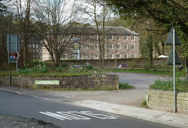 Part of the Cromford Mill complex from a car park entrance