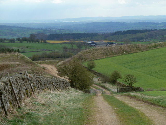 Farmland track towards quarry edge