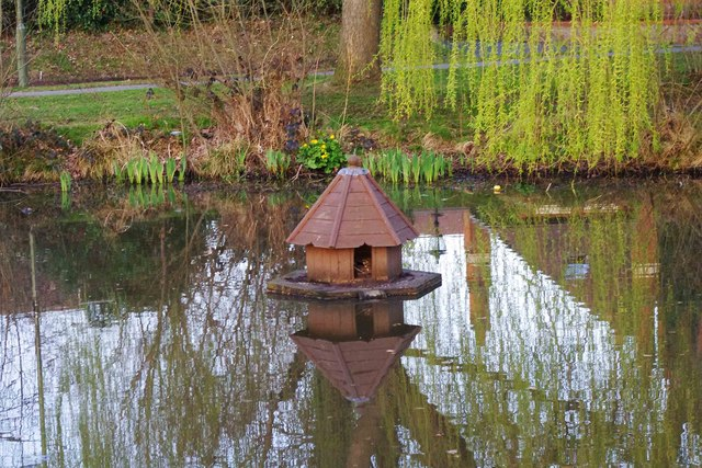 Duck house on the village pond, Bisley, Surrey