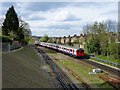 TQ2572 : Wimbledon train approaching Wimbledon Park station : Week 16