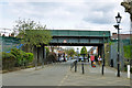 TQ2472 : Railway bridge at Wimbledon Park entrance by Robin Webster