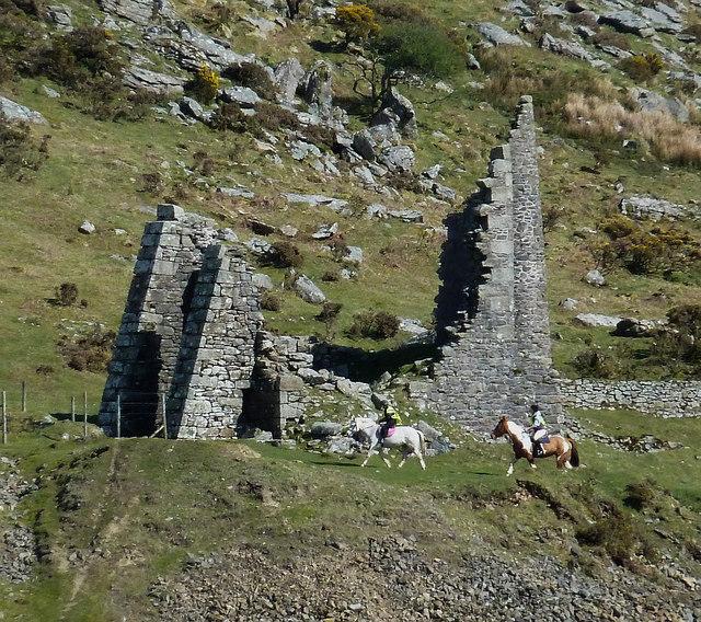 Riders pass Pearce's Shaft ruins